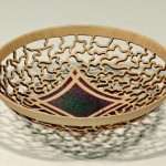 Margaret Garrard. Pierced and coloured bowl